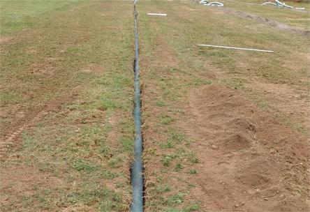 Drainage, terrain football, drain, tranchée, tuyau